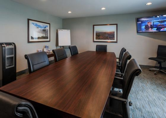 Image of the Rincon Room with plenty of chairs and meeting space located at Carpinteria Express